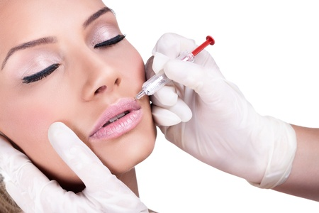 augmentation:  Woman gets cosmetic injection of botox. Beauty Treatment