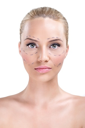 marked:  Portrait of a pretty womans face marked with lines for facial cosmetic surgery