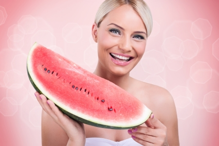 Smiling woman  with big slice of watermelon, summer fruit photo