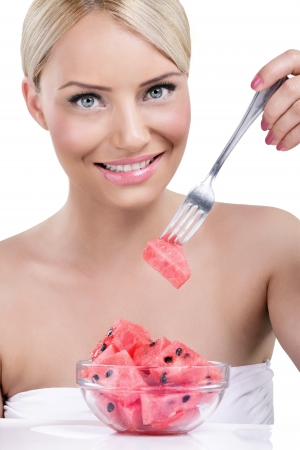 Beautiful woman eating watermelon-sweet tasty summer photo