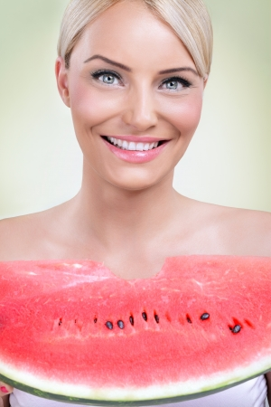 happy woman eating fresh slice of watermelon photo