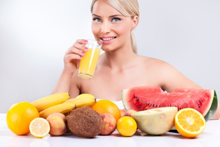 young woman with tropical fruit front her, healthy lifestyle photo