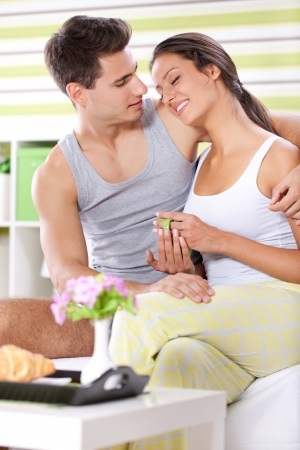 Young couple together enjoying in morning  photo