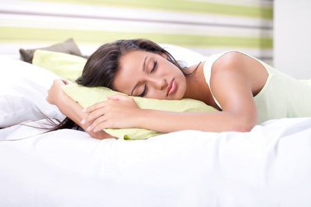 Beautiful young woman sleeping in bed Stock Photo - 15038506