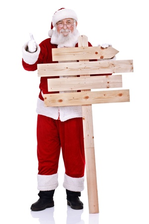 happy Santa Claus  holding wooden sign and showing thumb up, isolated on white background photo
