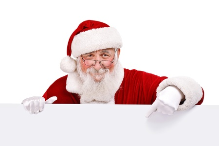 santa: Santa Claus pointing in white blank sign with smile, isolated on white background