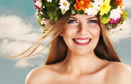 Beautiful woman smiling with flower wreath on head  photo