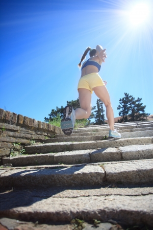 upstairs: woman running by steps on sunny day