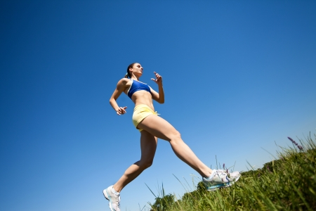 sporty woman running outdoor  photo
