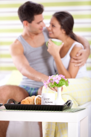 Sweet couple enjoying in morning with breakfast photo