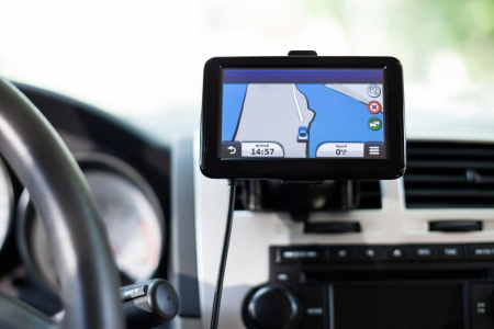 A close-up view of a GPS vehicle navigation system inside a car. Stock Photo