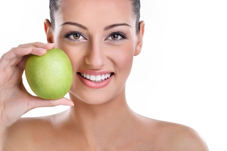 young woman with perfect healthy smiling holding green apple photo