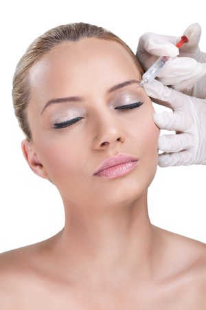 Woman receiving botox injection, Beauty Treatment photo