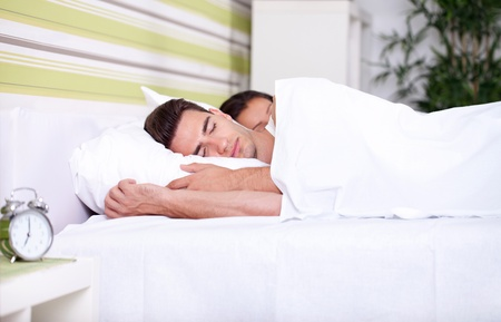 rest in peace:  Morning , young couple sleeping together in bed Stock Photo