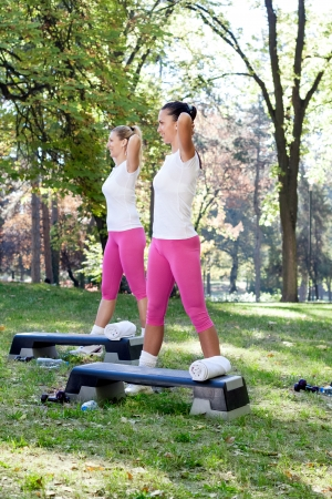young women exercise in park Stock Photo - 16217395