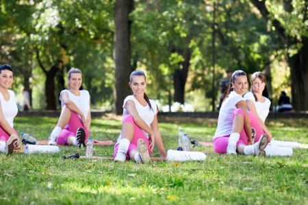 group of girls smiling and stretching in the park Stock Photo - 16217406