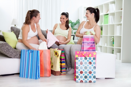 Happiness pregnant women with their shopping bags at home photo