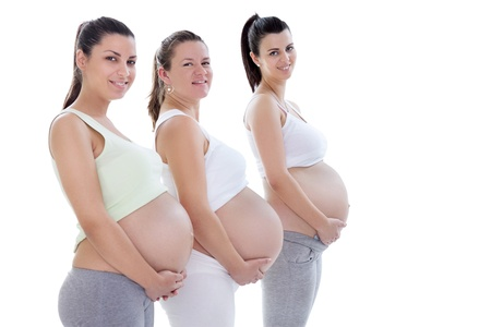 Young pregnant women in third trimester smiling and looking at camera photo