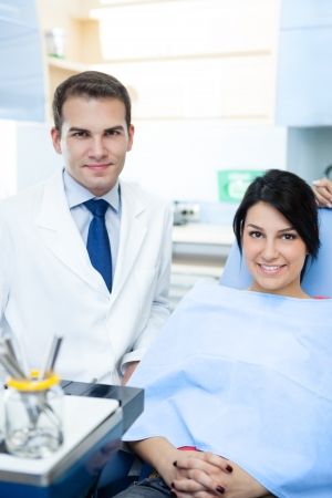 dental caries:  Friendly male dentist and patient Stock Photo