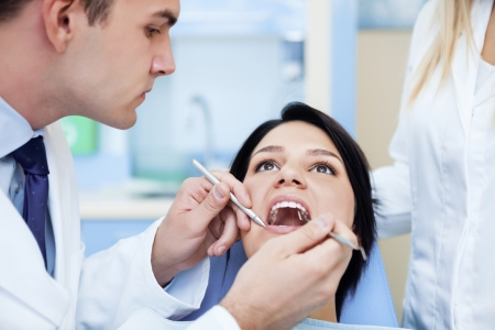 dentist working with patient. photo