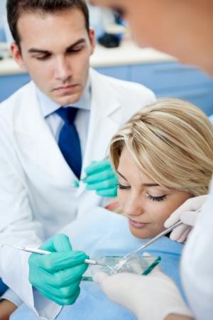 fillings: Dentist take dental powder from glass plate for preparing fillings