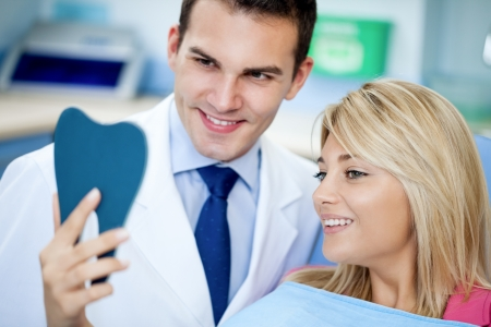 satisfied people: Dentist and satisfied patient with white teeth as a results of whitening treatment