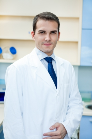 portrait of young handsome success doctor  photo