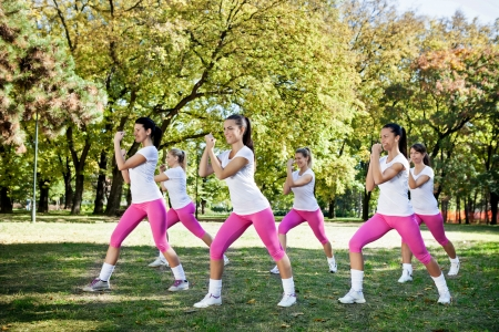 six persons:  Six young women  doing exercising, outdoor