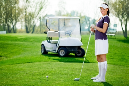 woman golf: Beautiful and young golfer
