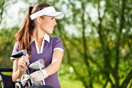 golf equipment: Gorgeous golfer lady with golf equipment