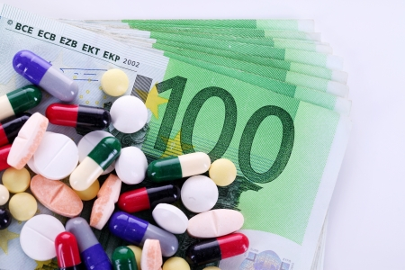 expensive:  Pills and money, concept expensive drugs Stock Photo