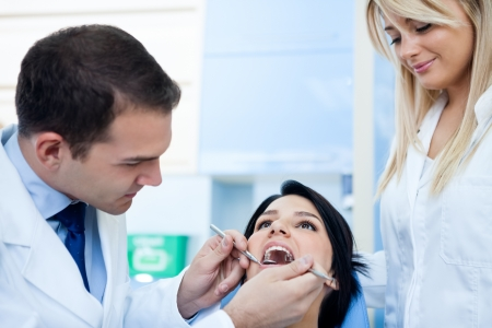 Dentist examines teeth of the patient on the dentist's chair Stock Photo - 16860990