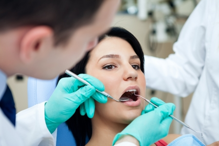 Medical treatment at the dentist office. Stock Photo - 16860993