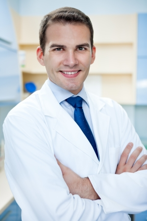 male dentist:  portrait of young handsome success doctor with arms crossed  Stock Photo