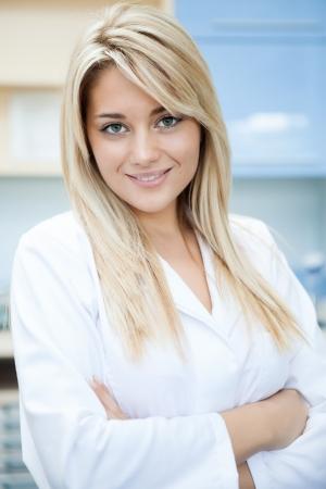 confident female doctor in white uniform smiling Stock Photo - 16860975