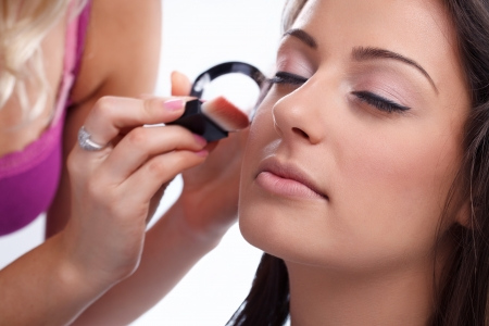make-up artist applying make-up on woman, close up  Stock Photo - 16861001