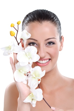 bodycare: Beauty face of the young beautiful woman with white orchid