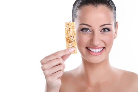 roughage:  Smiling young woman with muesli bar,  healthy eating