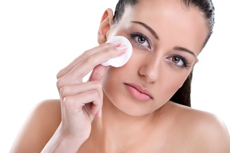 Young Beautiful woman cleaning skin on face with cotton pad Stock Photo - 16860986