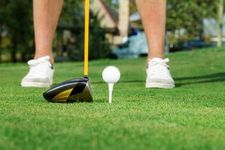 Male golfer ready to shot a golf ball  photo