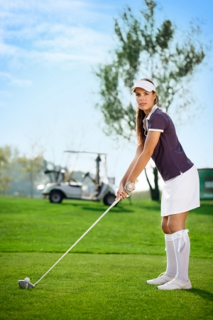 young golfer woman on golf course  photo