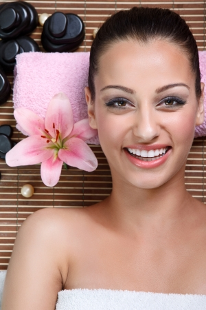Beautiful smiling woman in spa salon photo