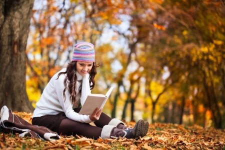 young beautiful girl in the autumn forest reading a book Stock Photo - 16860961