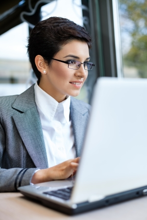 Young business woman with laptop Stock Photo - 16860978