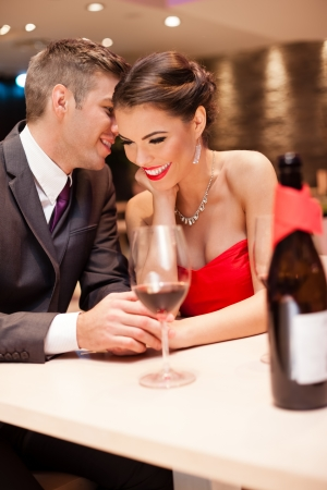young men whispers to his girlfriend, couple in love Stock Photo - 16860972