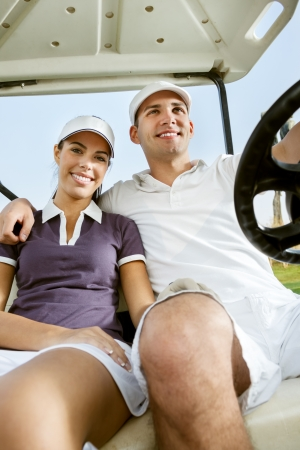 Couple in buggy in golf course photo