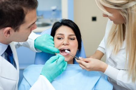Female patient at the dentist with open mouth photo