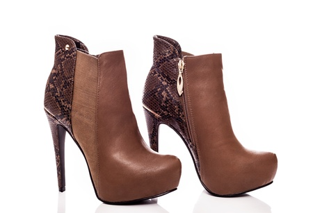 Brown female leather high-heeled boots  photo