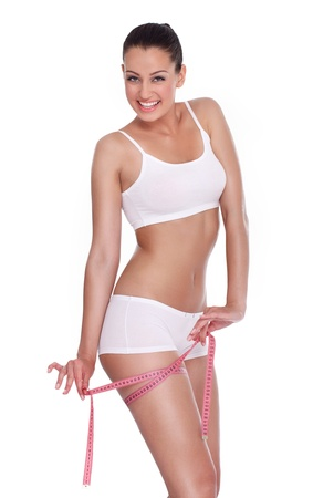 measure waist:  Happiness young woman measuring her hips, weight loss Stock Photo