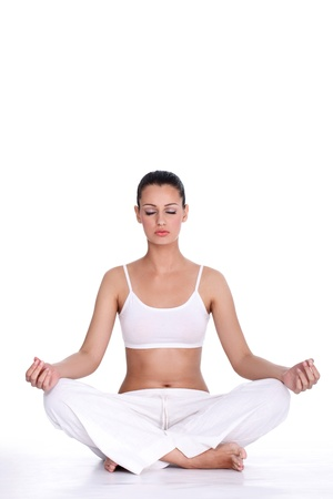 healthy young woman  with closed eyes meditating  over white background